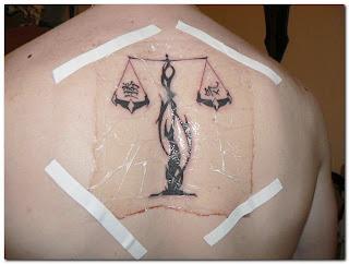 http://4.bp.blogspot.com/_eiBeHFUT6Lo/SzfYL15PP5I/AAAAAAAAAyE/9UT5XvzstFA/s320/Libra+Tattoo+Designs+back+body.jpg