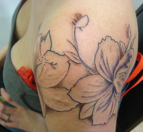 flower tattoo colors. flower tattoos red color
