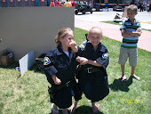 Haylee and Kylee dressed up as cops!