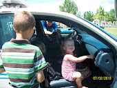 Brookelynn sitting in the front seat of a cop car