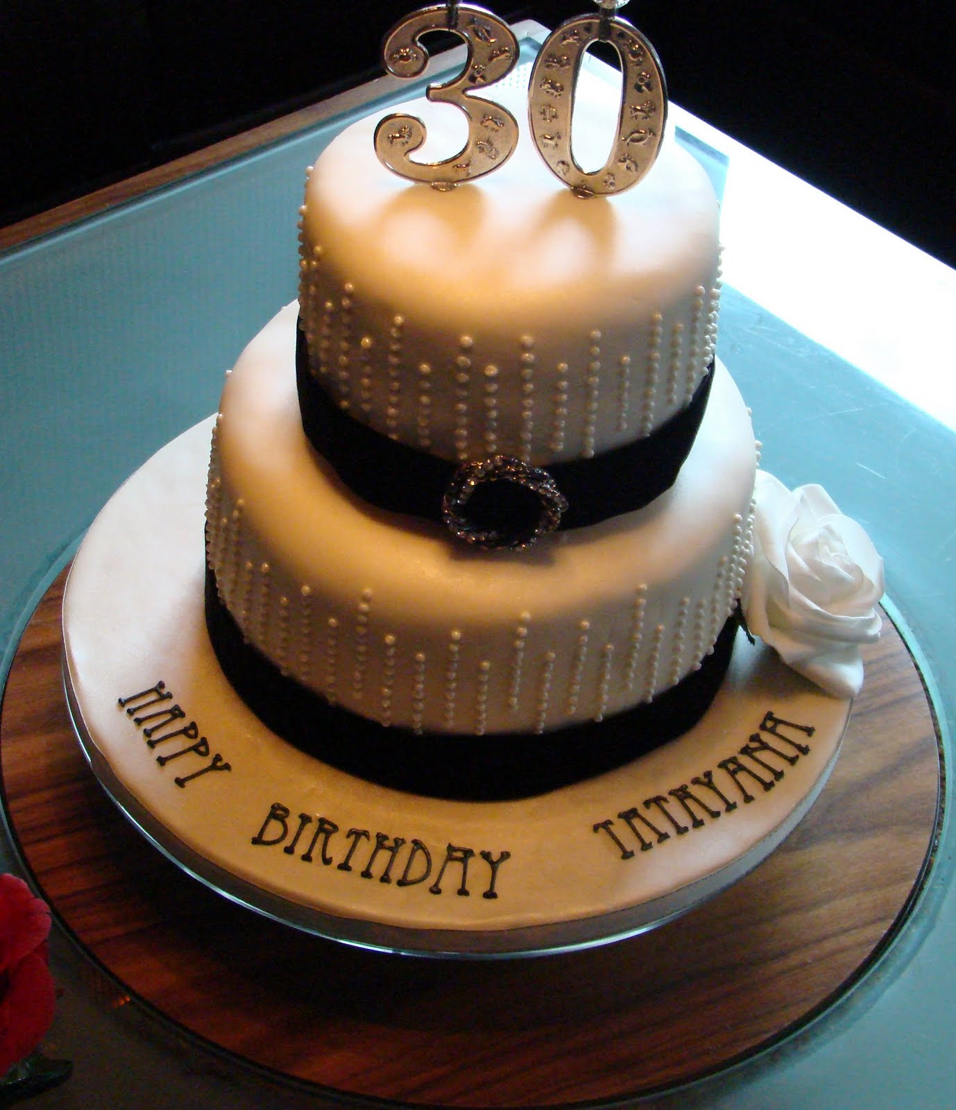 The Cake Was Embellished With Pipped Pearls Black Velvet Ribbon And Diamante Broach Perfect For An Elegant Celebration