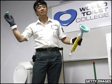 "Japanese ""Toilet professor"" Atsuhiro Katsumata talks to a class of toilet cleaners in Singapore (file photo)"