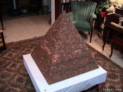 Pyramid Of Pennies,Another favorite  that has been circulating the web. This pyramid contains 289,318 pennies to beat  an old World Record. The owner has been adding to the pyramid and the website  says it now has 403,135 pennies.