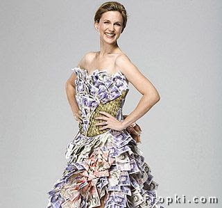 The dress was made  to help promote a new gigantic lottery fund in the UK. The dress is made from  Sterling Pound notes.