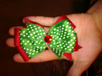 Green and Red Christmas bow with jewel center