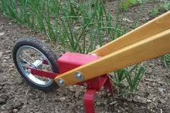 Gardening is a whole lot easier with a Planet Whizbang wheel hoe!