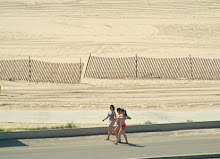 Girls walking by beach