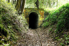 Toy rail track through tunnel in England