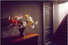 Arrangement of flowers on sideboard in hallway of french country hotel