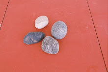 gray rocks on salmon colored wood