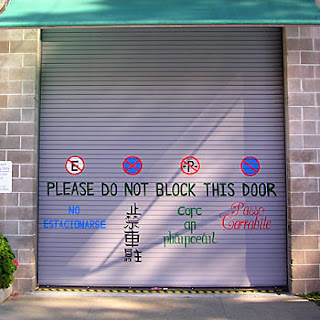 Sign on roll-up door: Please do not block this door