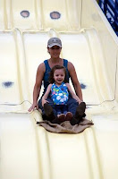 Amy Takes Sophia Down the Slide at the Fair