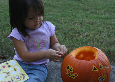 Gabi put the sticker-faces on the pumpkin.