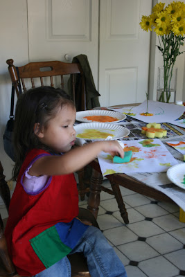 Gabi painting with sponge stamps