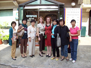 Posing for a group photo with members of the Women's Division of the Seoul Association of the Deaf