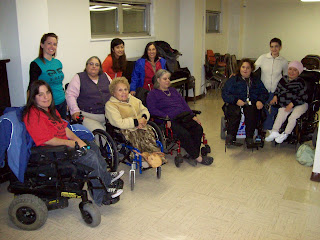 Women with disabilitied gather in community room in New York City