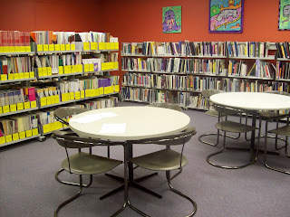 The library with reading tables at Women's Health Victoria