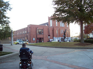 Viewed from the back, Mark goes towards Ebenezer Baptist Church across the street from the King Center