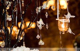 A elegant display of hanging crystals and candles.
