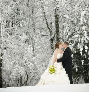 A gorgeous winter wedding couple photograph outside in the forest.