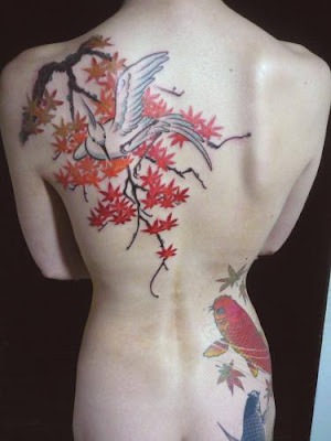 female body tattoos. cherry tree tattoo. chinese