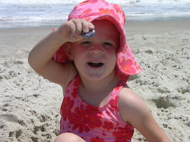Abby finding treasures in the sand