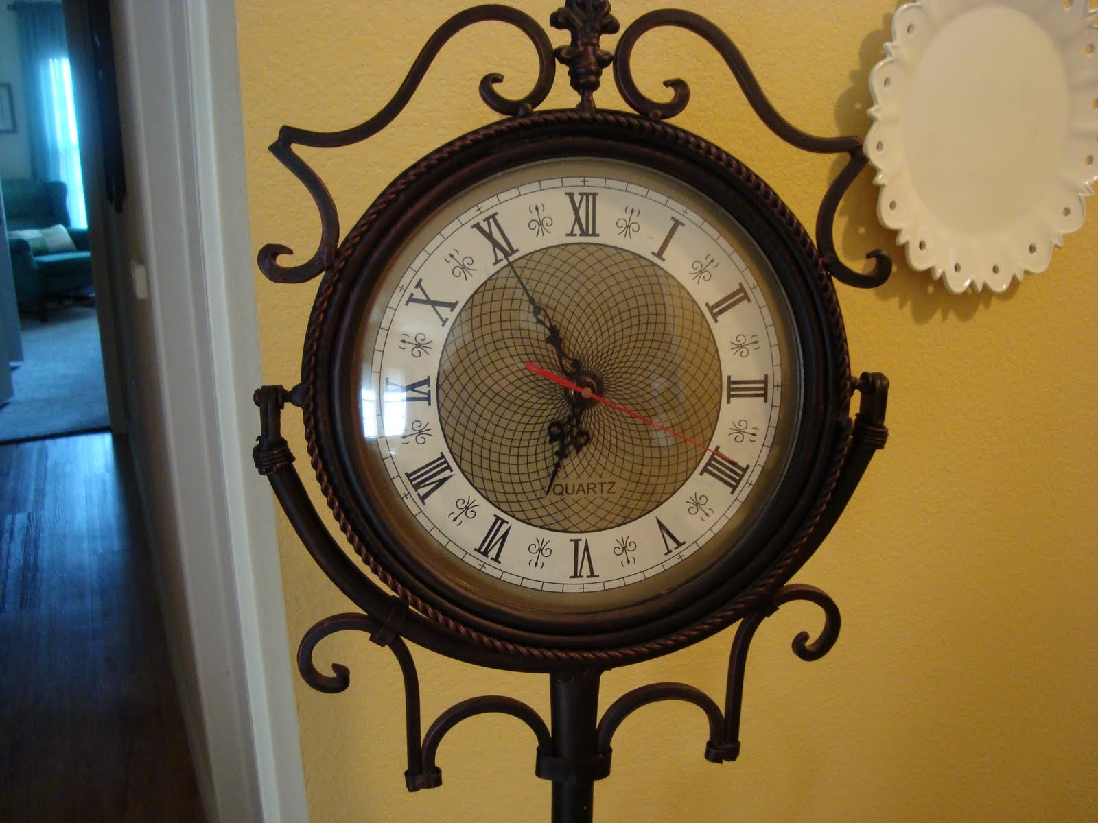 Wrought Iron Floor Clock With Unique Old Fashioned Flair