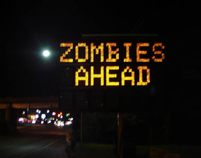 electronic road sign hacked CAUTION ZOMBIES AHEAD