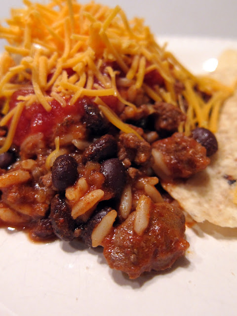 Taco Rice - one pot dish - taco meat, black beans, tomato sauce and rice tossed together - top with favorite taco toppings - fun change to taco night!