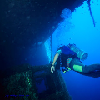 Diver approaching a lorry on the wreck of the Zenobia