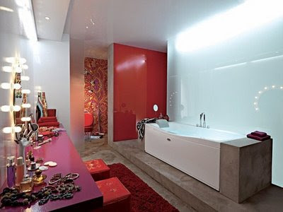Bathroom-with-lamps-bath-tub-floor-and-red-carpet