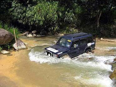 Adventure trail with 4X Wheel Drive and water rafting
