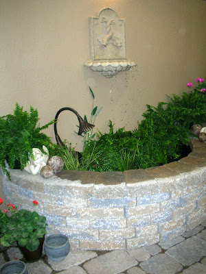 A Wall Fountain Can Be Self Contained As A Water Feature Or As A Feature In  A Much Larger Pond.