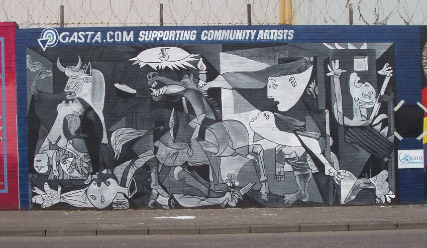 Tourists drawn to belfast 39 s international wall murals for Mural guernica