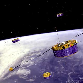 Representación artística de los cuatro satélites Clúster sobre la Tierra