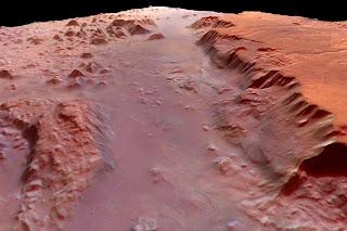 Los investigadores creen que el meteorito Allan Hills proviene de Eos Chasma en Marte, cerca del horizonte en esta imagen de la Mars Express. El cañón se encuentra en otro más grande llamado Valles Marineris