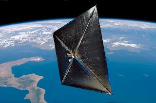 Concepto artístico de una vela solar orbitando la Tierra