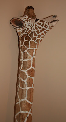 Painted giraffe driftwood sculpture