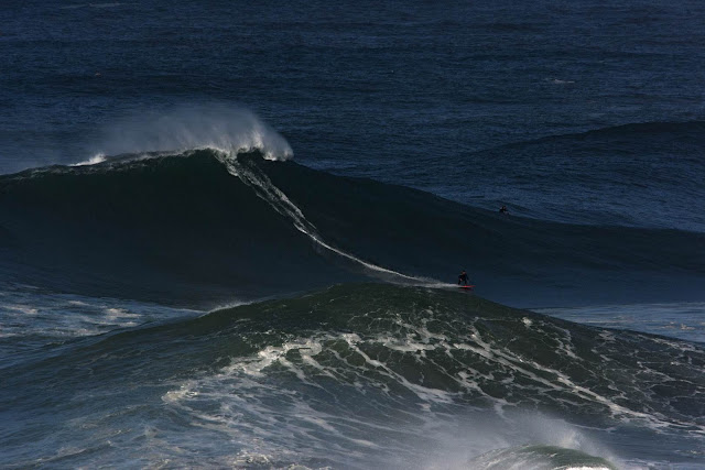 McNamara surfs giant waves (7 to 9 meters) at Praia do Norte, Nazaré.