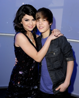 Justin Bieber is a girl who is also a singer and her name is Selena Gomez.