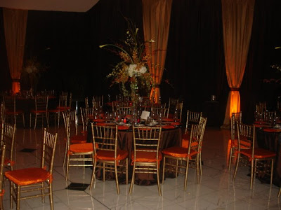The back wall of the ballroom was draped in brown and gold satin fabrics