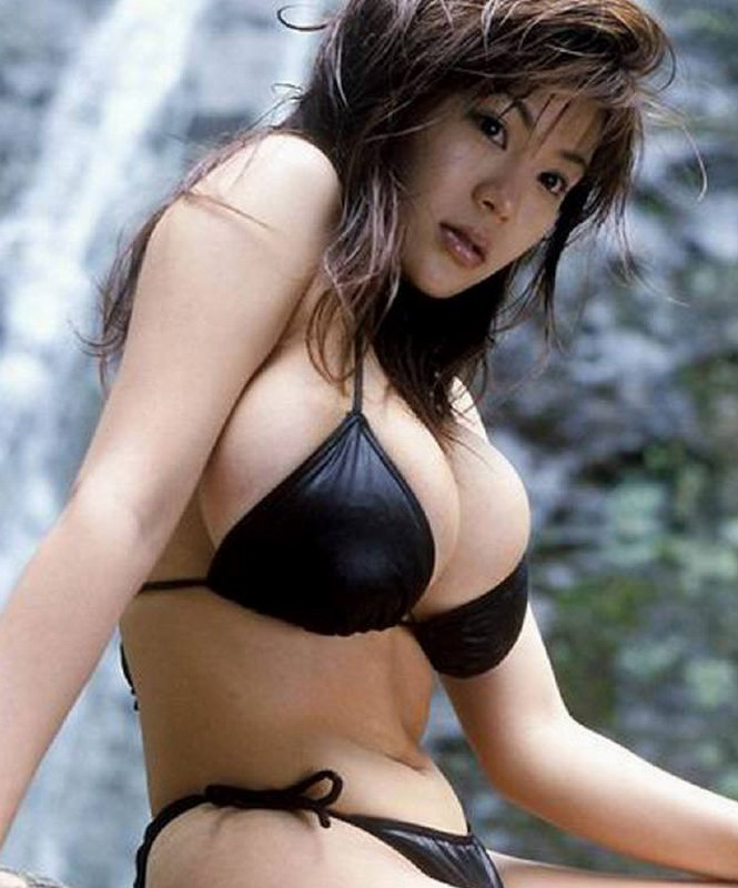 Asian girl with massive bulges in shiny black bikini.