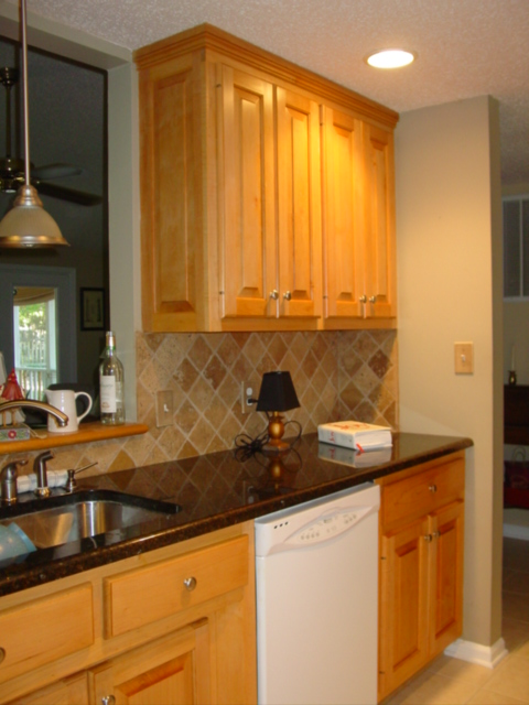 Calvert painting finished stained kitchen cabinets for Cost to refurbish kitchen cabinets