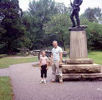 father and son at gettysburg monument