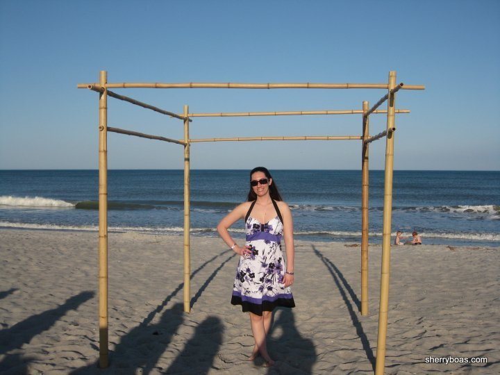 A beachside wedding arbor made from bamboo