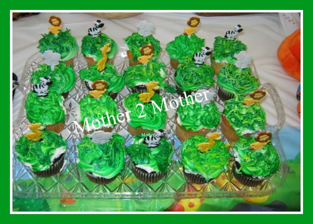 Jungle themed cake is a must we used jungle themed cupcakes i had