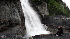 Dorothy Taking a Picture of Waterfall in Seward