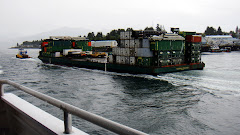 Shipping Barge Carrying Supplies to Inaccessible Towns
