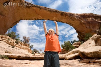 Boy Hanging Natural Bridge Illusion