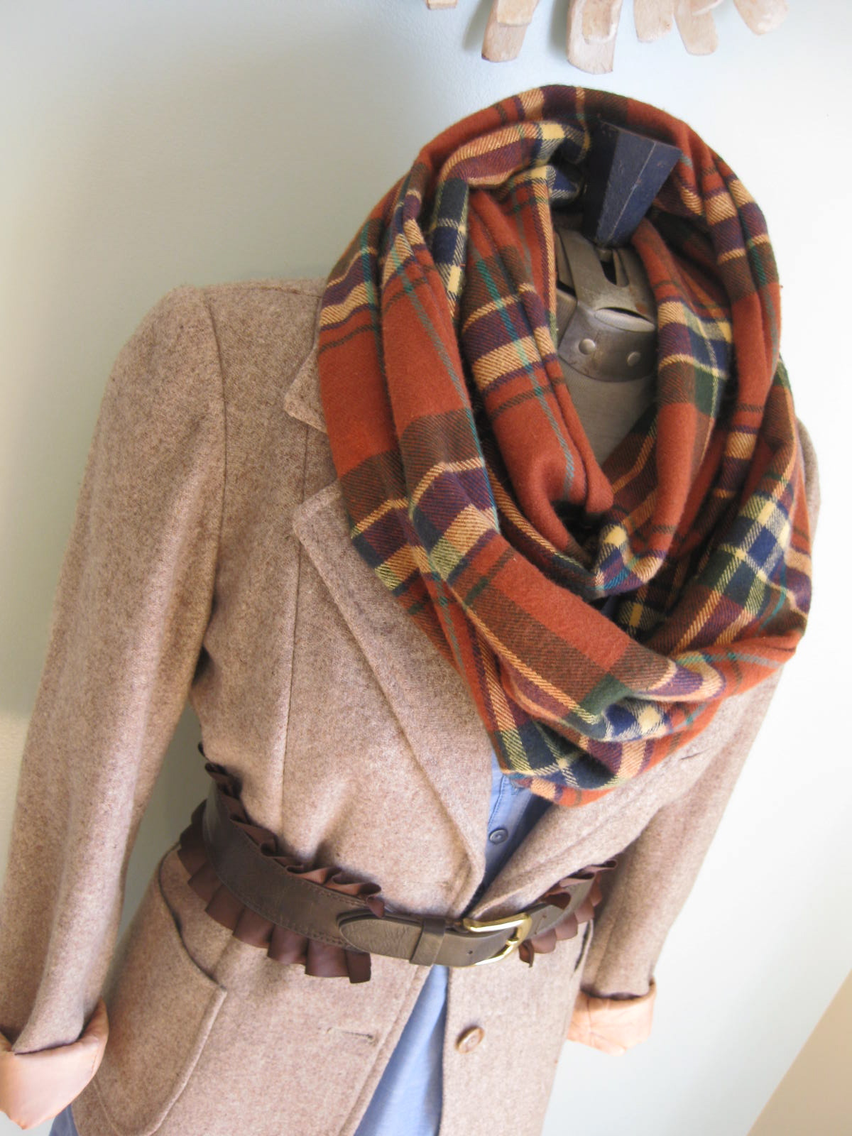 A scarf, plural scarves, is a piece of fabric worn around the neck for warmth, sun protection, cleanliness, fashion, or religious reasons. They can be made in a variety of different materials such as wool, cashmere, linen or cotton.